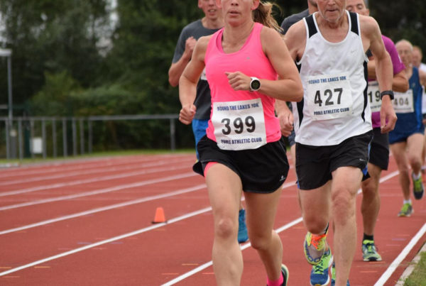 Female runner at 3000m track event at Ashdown, Poole