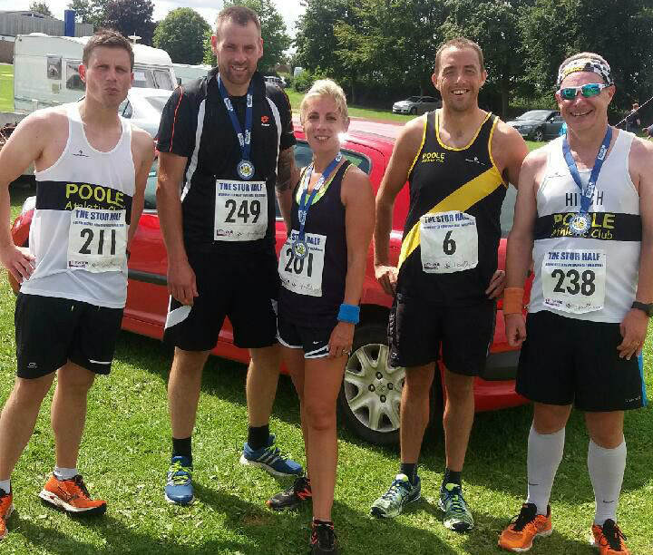 Poole Ac runners outside with medals from the Stur Half Marathon